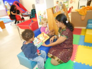 Our Family Support Worker reads to eager listeners.